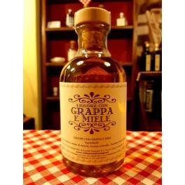 Liquore con grappa e miele 1 L.